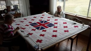 Members of the Twilight Quilters' Guild working on the WWI Memorial Red Cross Quilt